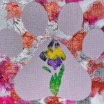 An abstract background of pink silver orange. With a solid purple pawprint on top with an iris in the middle of the pad of the paw.