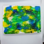 an abstract painting of yellow, hues of green, and blue